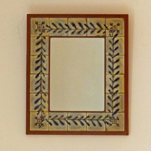 A Small Pottery and Oak Framed Mirror
